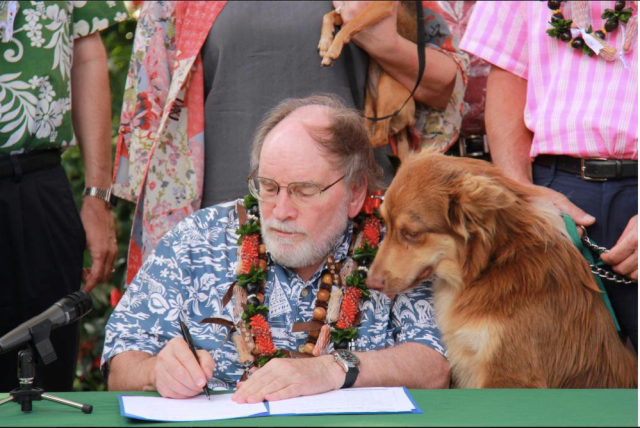 Senator Abercrombie signs animal rights bill into law